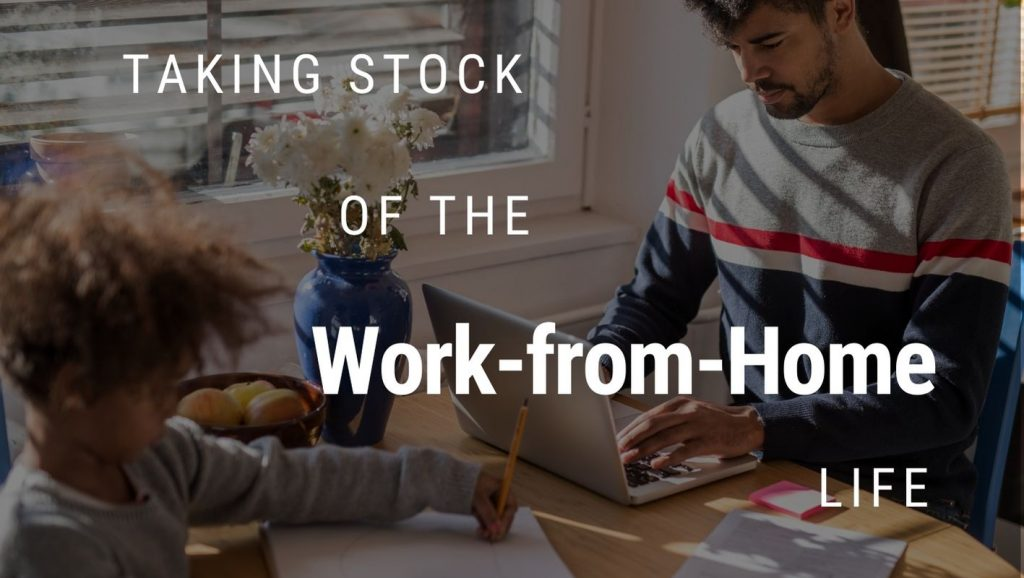 A father and son work work at a kitchen table with text overlaid: Taking stock of the work-from-home life.